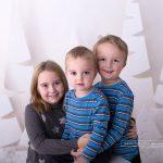 Geschwisterfotos, wie diese Nahaufnahme der drei, ist eine Erinnerung für die Eltern