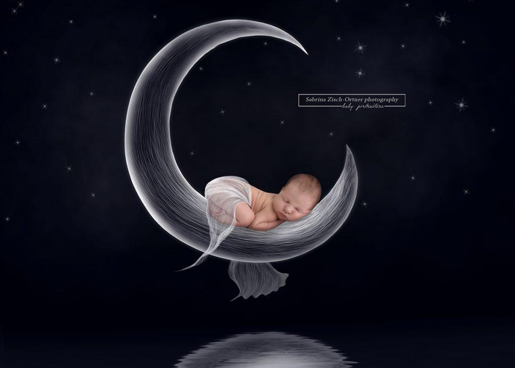 neugeborenes Baby auf einer Bleistiftzeichnung des Mondes