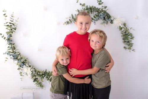 Geschwisterfoto als Erinnerung fuer Oma und Opa